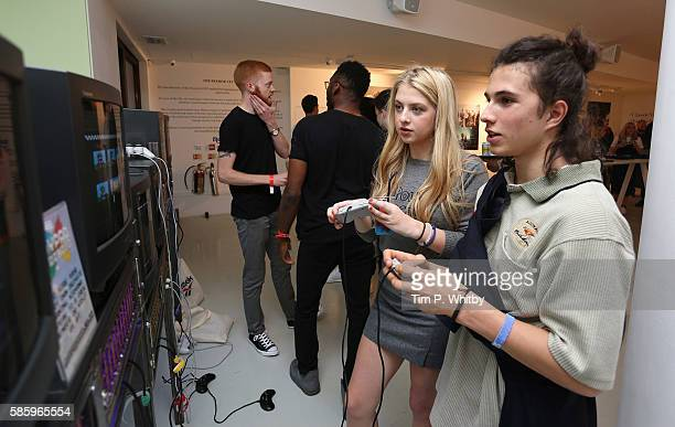Anais Gallagher and Dom Sesto playing retro video games at the Reebok Classic 90's Collection Event on August 4 2016 at Rook and Raven Gallery in...