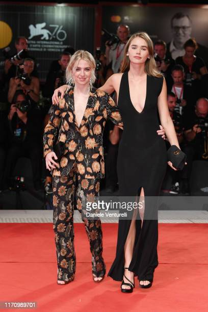 Anais Gallagher and Gabriella Brooks walk the red carpet ahead of the Ad Astra screening during during the 76th Venice Film Festival at Sala Grande...