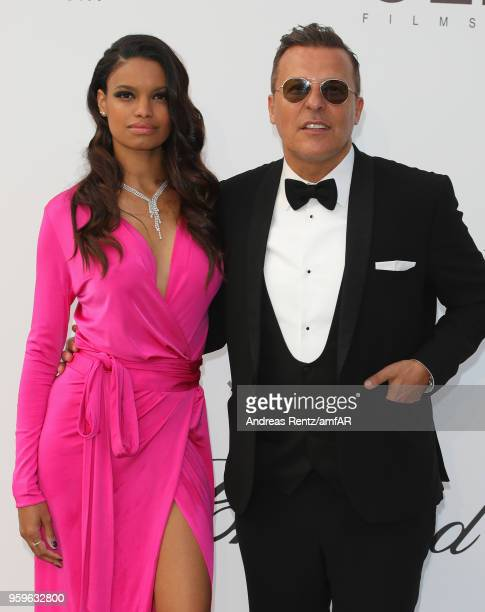 Anais Monory and Jean Roch arrive at the amfAR Gala Cannes 2018 at Hotel du CapEdenRoc on May 17 2018 in Cap d'Antibes France