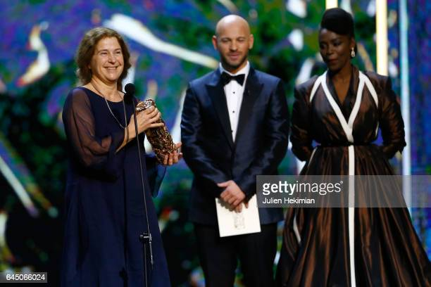Anais Romand receives the Cesar of Best Costume Design for 'La Danseuse' given by Franck Gastambide and Aissa Maiga during the Cesar Film Awards...
