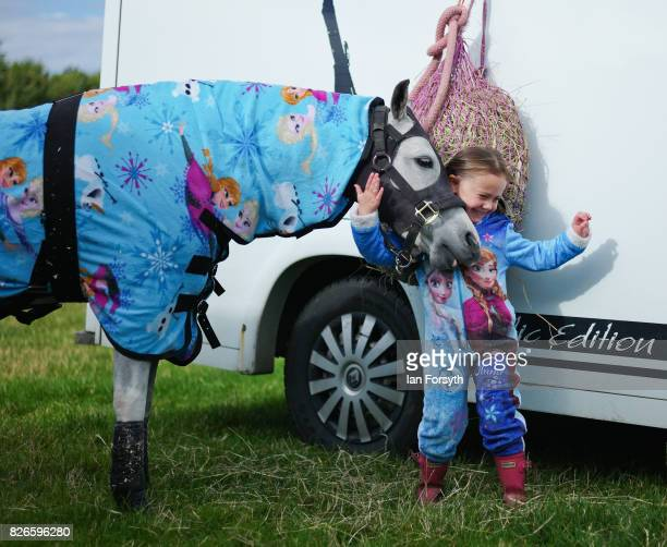 Anais Wall from Durham stands with her horse in matching onesies during the Osmotherley Country Show on August 5, 2017 in Osmotherley, England. The...