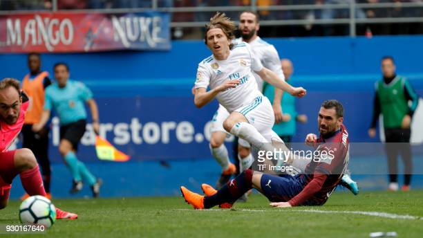 Anaitz Arbilla of Eibar and Luka Modric of Real Madrid battle for the ball during the La Liga match between Eibar and Real Madrid at Estadio...