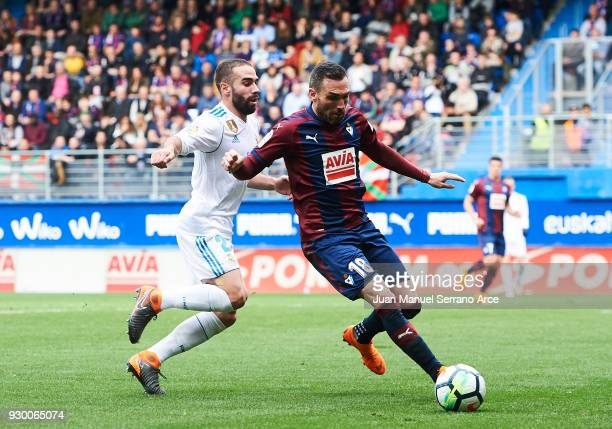 Anaitz Arbilla of SD Eibar duels for the ball with Daniel Carvajal of Real Madrid during the La Liga match between SD Eibar and Real Madrid at Ipurua...