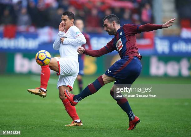 Anaitz Arbilla of SD Eibar duels for the ball with Wissam Ben Yedder of Sevilla FC during the La Liga match between SD Eibar and Sevilla FC at Ipurua...