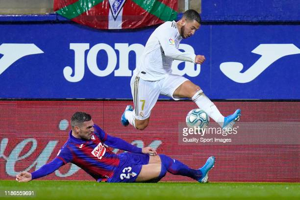 Anaitz Arbilla of SD Eibar SAD battles for the ball with Eden Hazard of Real Madrid CF during the Liga match between SD Eibar SAD and Real Madrid CF...