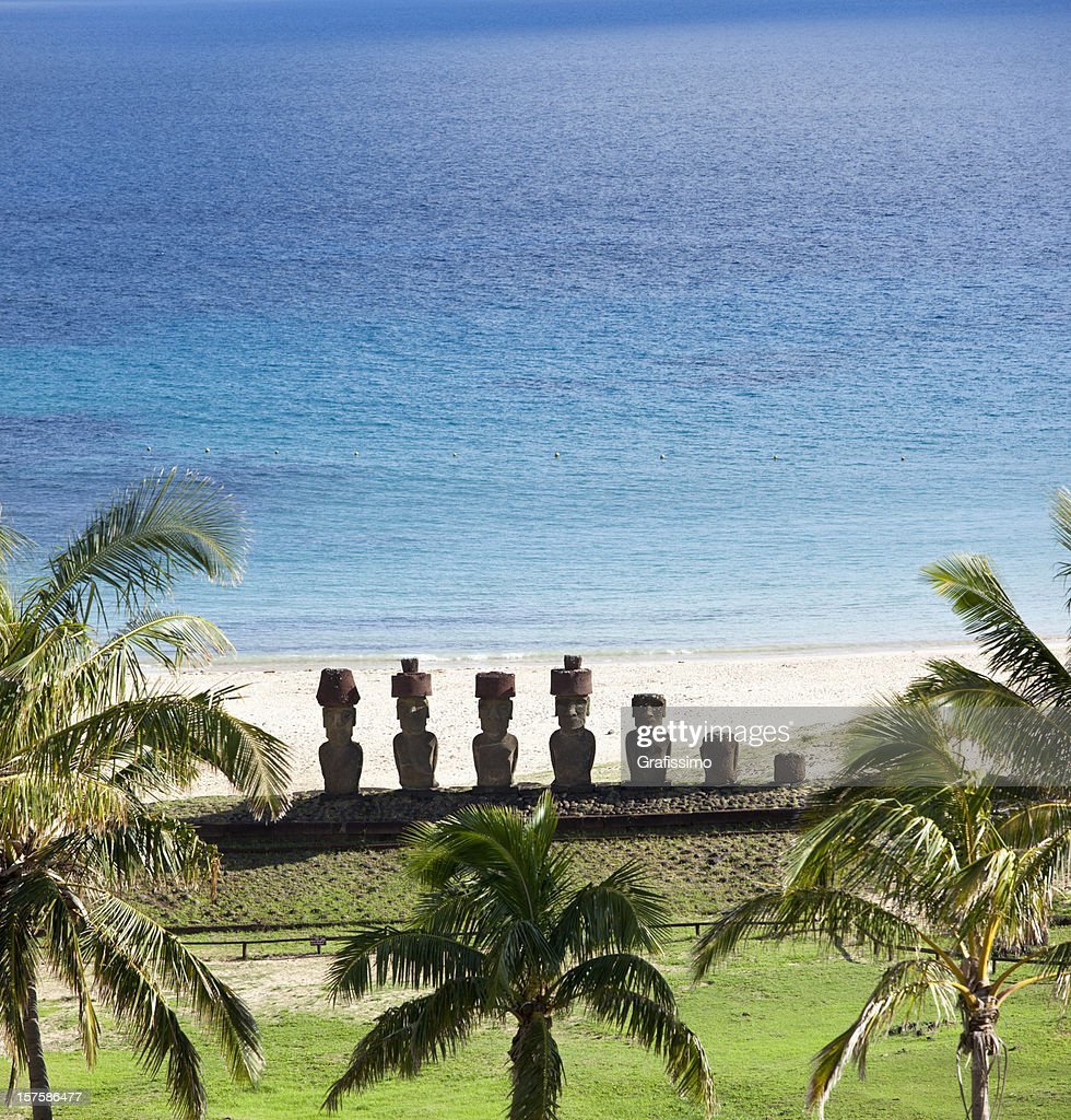 Easter Island Beaches: Anakena Beach With Moai On Easter Island Chile Stock Photo