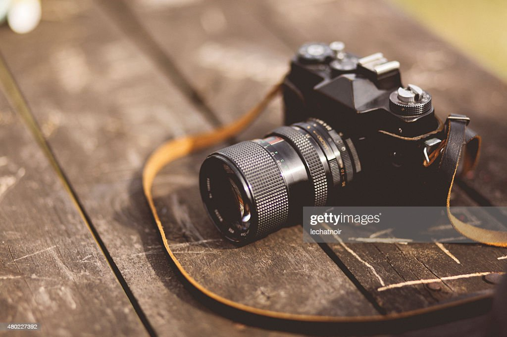 analog film camera on the table : Stock Photo