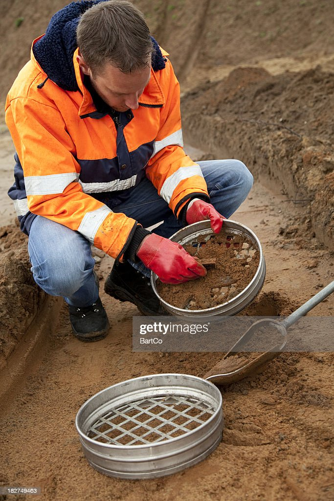 Analysing the soil, archeologist and environmetal research. : Stock Photo