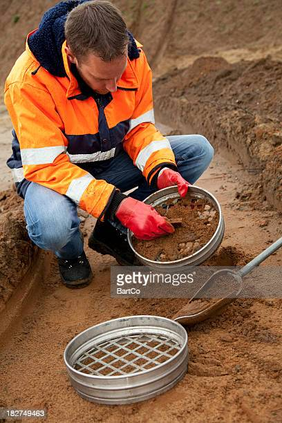 Analysing the soil, archeologist and environmetal research.