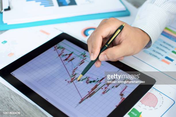 analysis graph stock market trading with stock chart data, financial and investment concept.