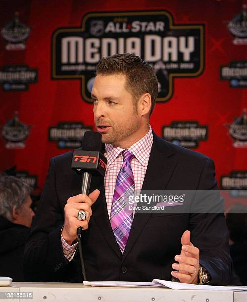 TSN analyst Aaron Ward speaks during an NHL Network broadcast at the 2012 NHL AllStar Game Player Media Availability at the Westin Ottawa on January...