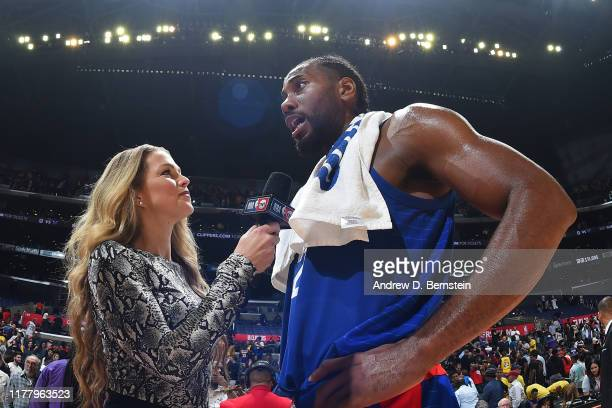 Analyst Allie LaForce interviews Kawhi Leonard of the LA Clippers after the game against the Los Angeles Lakers on October 22 2019 at STAPLES Center...