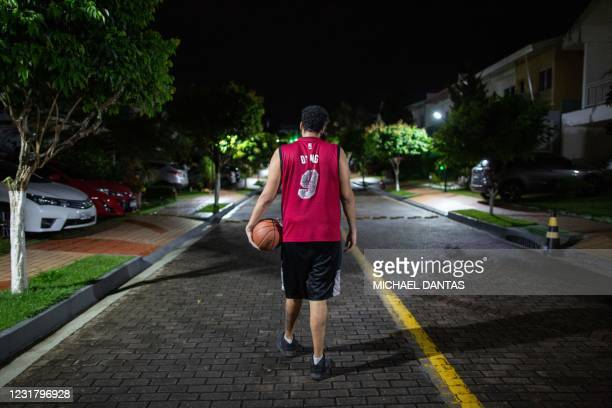 Analyst and amateur basketball player Thiago Rocha who recovered from COVID-19, walks outside his home in Manaus, Brazil, on January 28, 2021. -...