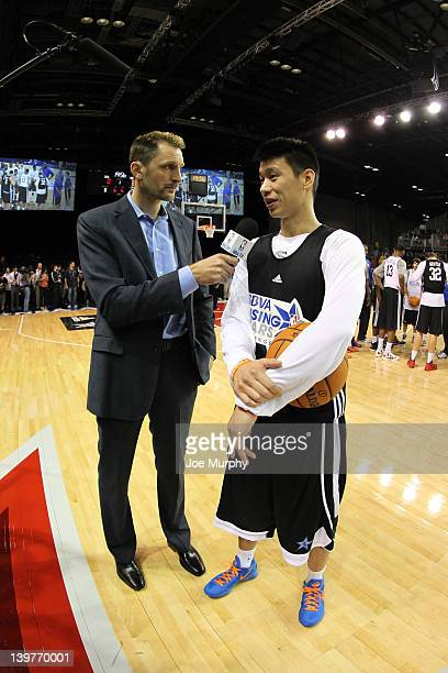 Analyst and NBA Legend Brent Barry interviews Jeremy Lin of the New York Knicks during the BBVA Rising Stars Challenge Practice on center court at...
