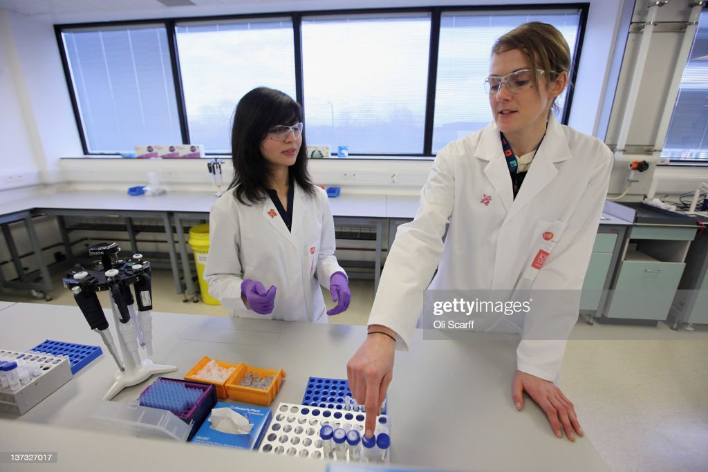 Analyst Arian Nemani explains to Kelly Sotherton (R), a British heptathlete, how urine samples are split in the anti-doping laboratory which will test athlete's samples from the London 2012 Games on January 19, 2012 in Harlow, England. The facility, which will be provided by GSK and operated by King's College London, will test over 6250 samples throughout the Olympic and Paralympic Games. Over 150 anti-doping scientists will work in the laboratory, which measures the size of seven tennis courts, 24 hours a day.