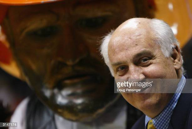 CBS analyst Billy Packer looks on as the the Oklahoma State Cowboys mascot attempts to get some television time before the start of the fourth round...