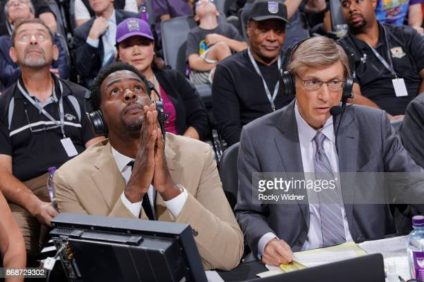 TV analyst Chris Webber and sportscaster Marv Albert watch a tribute during the game between the New Orleans Pelicans and Sacramento Kings on October...