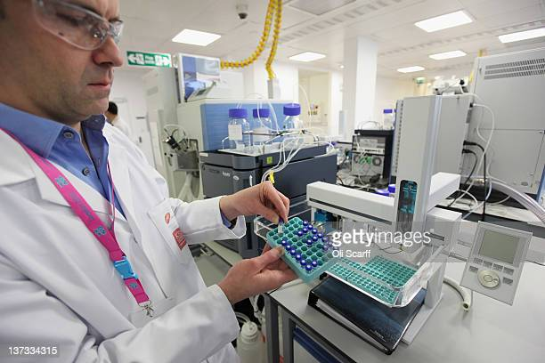 Analyst Christiaan Bartlett assesses samples in the antidoping laboratory which will test athlete's samples from the London 2012 Games on January 19...