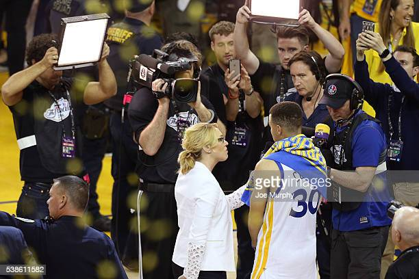 Analyst Doris Burke interviews Stephen Curry of the Golden State Warriors after Game Two of the 2016 NBA Finals against the Cleveland Cavaliers on...