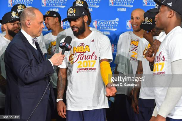 Analyst Ernie Johnson interviews Kyrie Irving of the Cleveland Cavaliers during the photo shoot after winning Game Five of the Eastern Conference...