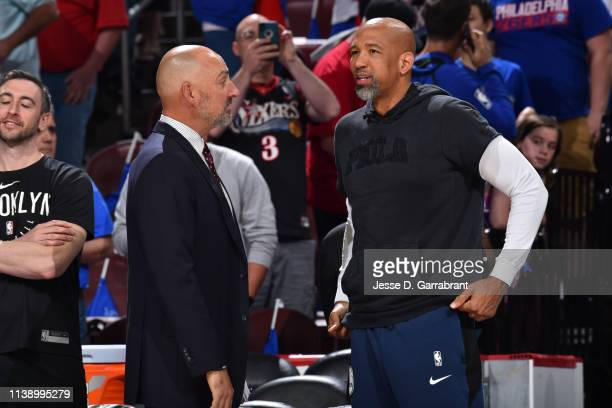 TV analyst for ABC and ESPN Jon Barry and Philadelphia 76ers assistant coach Monty Williams talk prior to a game between the Brooklyn Nets and the...