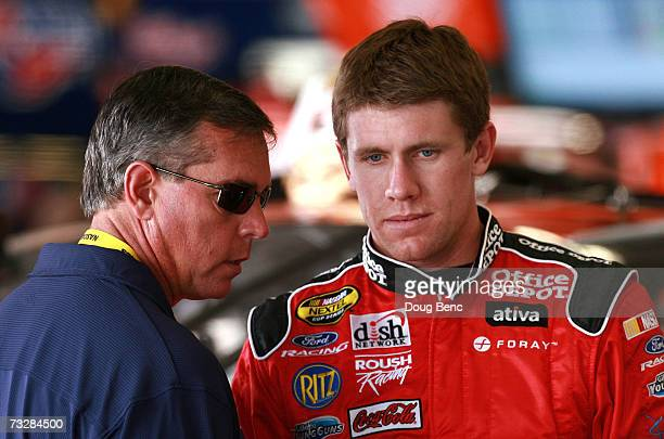 Analyst Jeff Hammond talks with Carl Edwards, driver of the Office Depot Ford lduring practice for the Daytona 500 at Daytona International Speedway...