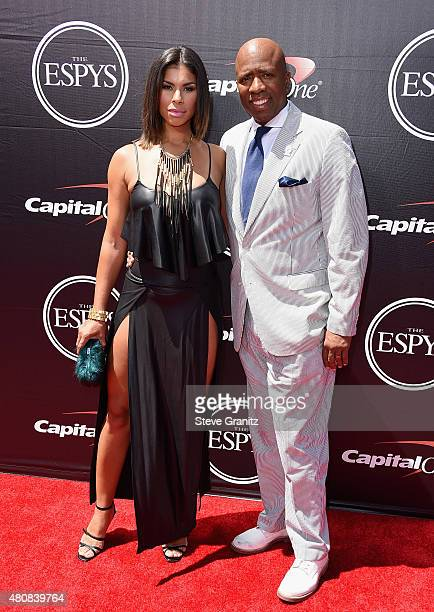 NBA analyst Kenny Smith and Gwendolyn Osbourne attend The 2015 ESPYS at Microsoft Theater on July 15 2015 in Los Angeles California