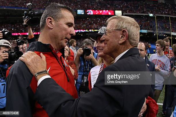 Analyst Lou Holtz congratulates Head coach Urban Meyer of the Ohio State Buckeyes after defeating the Alabama Crimson Tide in the All State Sugar...