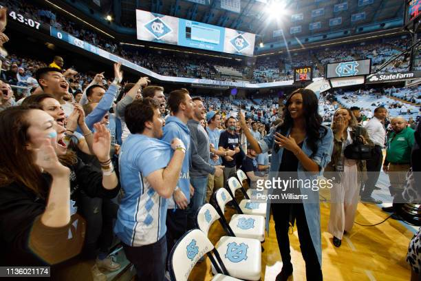 ESPN analyst Maria Taylor with fans of the North Carolina Tar Heels cheering during a game against the Duke Blue Devils on March 09 2019 at the Dean...