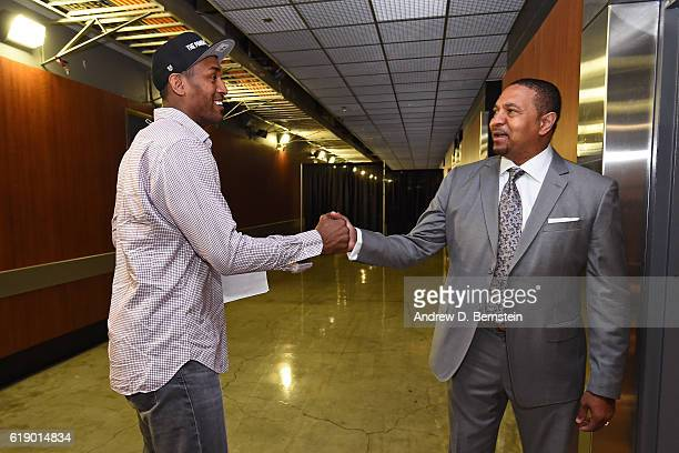 Analyst Mark Jackson shakes hands with Metta World Peace of the Los Angeles Lakers before the game against the Houston Rockets on October 26 2016 at...