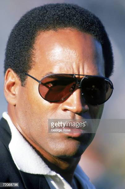 Analyst OJ Simpson looks on during a preseason game of the Houston Oilers against Los Angeles Raiders at OaklandAlameda County Coliseum on August 26...
