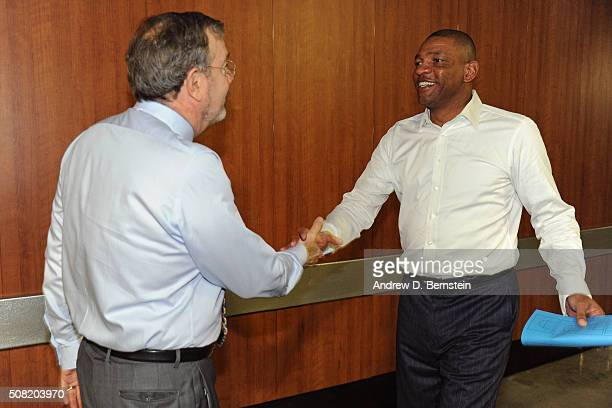 Analyst P J Carlesimo shakes the hand of Doc Rivers of the Los Angeles Clippers after the game against the Chicago Bulls at STAPLES Center on January...
