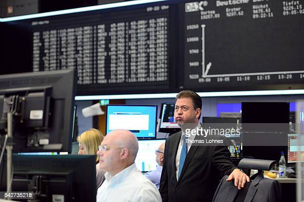 Analyst Robert Halver reacts at the Frankfurt Stock exchange the day after a majority of the British public voted for leaving the European Union on...