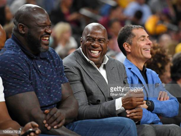 NBA analyst Shaquille O'Neal Los Angeles Lakers president of basketball operations Earvin Magic Johnson and Lakers general manager Rob Pelinka share...