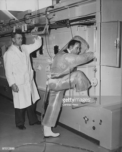 Analytical Operator Douglas Niell looks on as Safety Foreman Leslie Jones prepares to enter a radioactive analytical cell for inspection at the...