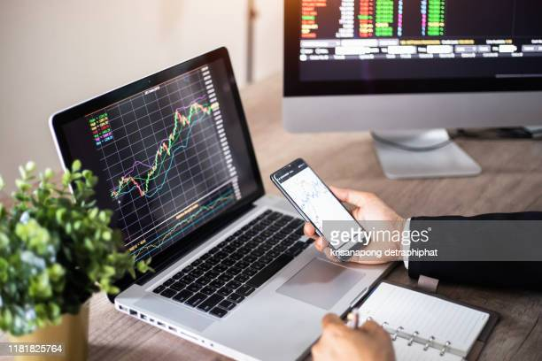 analyzing data. close-up of  businessman  working  in creative office,business, do this deal on a stock exchange. people working in the office.,stock market - bitcoin stock pictures, royalty-free photos & images