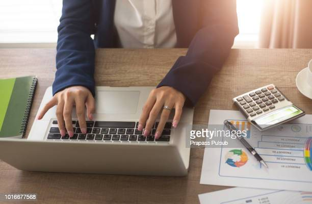 analyzing data, graphs and reports for investment purposes - input device stock photos and pictures