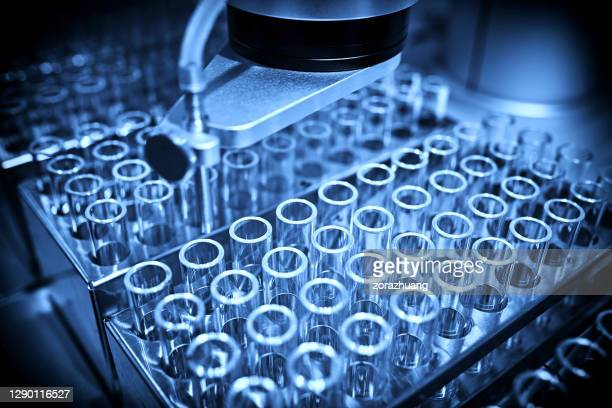 analyzing samples in test tube backgrounds - medical sample stock pictures, royalty-free photos & images