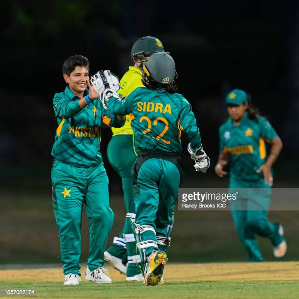 Anam Amin and Sidra Amin of Pakistan celebrates the dismissal of Laura Wolvaardt of South Africa during a warmup match at Coolidge Cricket Ground on...