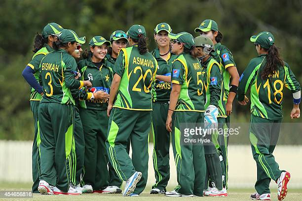 Anam Amin of Pakistan celebrates with team mates after dismissing Elyse Villani of Australia during the women's international series T20 match...