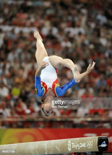 Anamaria Tamirjan of Romania on the beam during the artistic gymnastics team event at the National Indoor Stadium during Day 5 of the Beijing 2008...