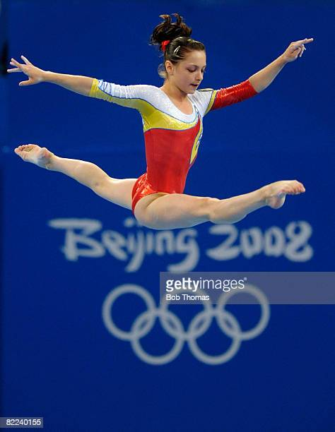 Anamaria Tamirjan of Romania performs on the balance beam during qualification for the women's artistic gymnastics event held at the National Indoor...