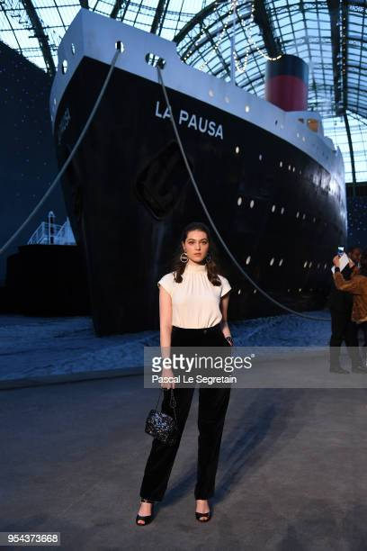Anamaria Vartolomei attends the Chanel Cruise 2018/2019 Collection at Le Grand Palais on May 3 2018 in Paris France