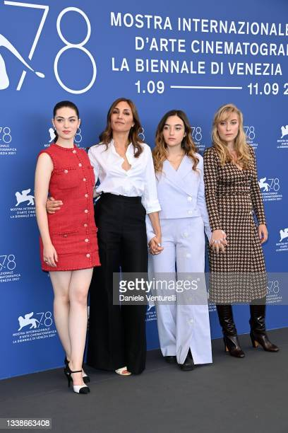 """Anamaria Vartolomei, director Audrey Diwan, Luàna Bajrami and Louise Orry Diquero attend the photocall of """"L'Evenement"""" during the 78th Venice..."""