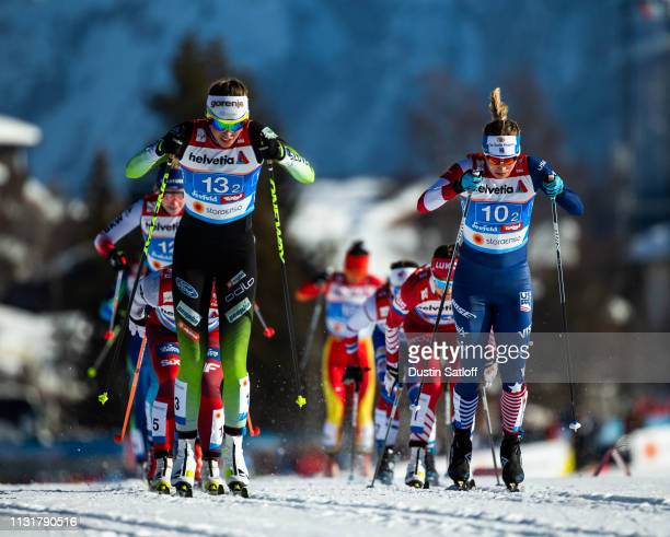Anamarija Lampic of Slovenia and Jessica Diggins of the United States compete in the Cross Country Women's Team Sprint semifinal race during the FIS...