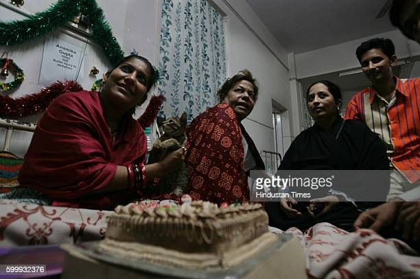 Anamika Gupta holds a kitten in front of the cake bought for her by Nasrin Ashraf Qureishi daughter of her next bed patient at JJ hospital on the eve...