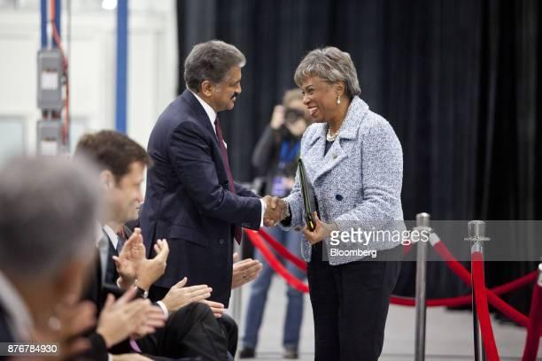 Anand Mahindra chairman of Mahindra Mahindra Ltd center left shakes hands with Representative Brenda Lawrence a Democrat from Michigan during an...