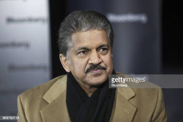 Anand Mahindra chairman of Mahindra Mahindra Ltd listens during a Bloomberg Television interview on day two of the World Economic Forum in Davos...