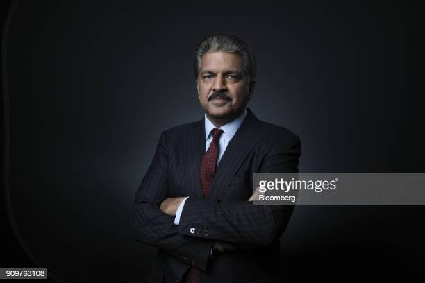 Anand Mahindra chairman of Mahindra Mahindra Ltd poses for a photograph following a Bloomberg Television interview on day two of the World Economic...