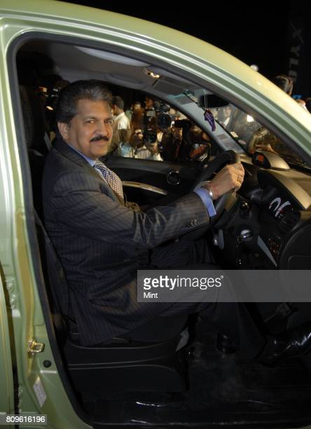 Anand Mahindra Vice president of Mahindra Mahindra Auto sits on the front seat of Newly launched Mahindra Xylo car at the company's plant in Nashik